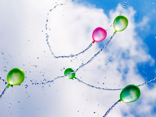 Water Balloons in Flight