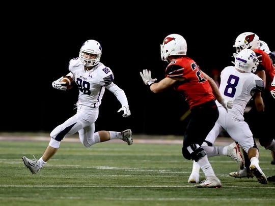 Shasta's James Weaver carries the ball against Bishop
