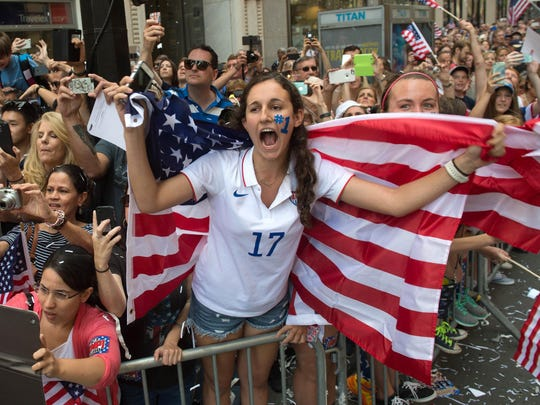 Lucie Keleman of Westchester County cheers as U.S. Women's World Cup soccer champions make their way up Broadway to City Hall, during a ticker tape parade honoring the team Friday, July 10, 2015, in New York.