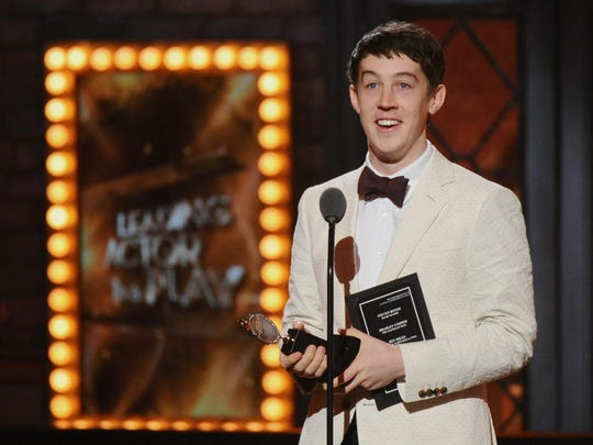 """Alex Sharp accepts the Tony Award for best performance by an actor in a leading role in a play for """"The Curious Incident of the Dog in the Night-Time"""" at the 69th annual Tony Awards at Radio City Music Hall in June. Sharp's speech was inspired, in part, by a performance in December 2014 given to an audience on the autism spectrum."""