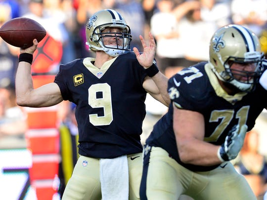 New Orleans Saints quarterback Drew Brees (9) throws as offensive tackle Ryan Ramczyk (71) provides coverage against the Los Angeles Rams defense during the second half at the Los Angeles Memorial Coliseum on Nov. 26, 2017.