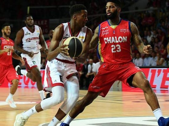 SIG's French Frank Ntilikina (L) is challenged by Chalon's US Cameron Clark (R) during the French ProA basketball playoff final match between Strasbourg and Chalon, in Strasbourg, north-eastern France, on June 19, 2017.  Ntilikina, a 6-5 18-year-old guard, is considered one of the favorites for the Mavericks at No. 9 in the first round of the 2017 NBA Draft Thursday.
