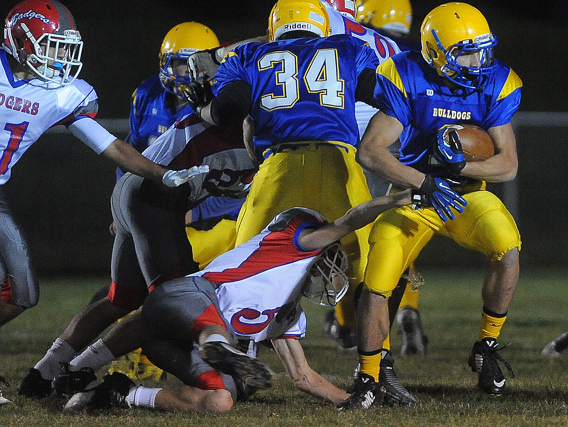 Baltic High School's Sam Clark drags Arlington/Lake Preston's Tyson Toucedo to gain yards during their game in Baltic on Tuesday, Oct. 27, 2015.