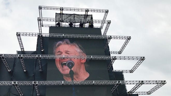 Steve Miller is seen on one of two video screens, designed to resemble the Indianapolis Motor Speedway Pagoda, that flanked Friday's Carb Day stage.