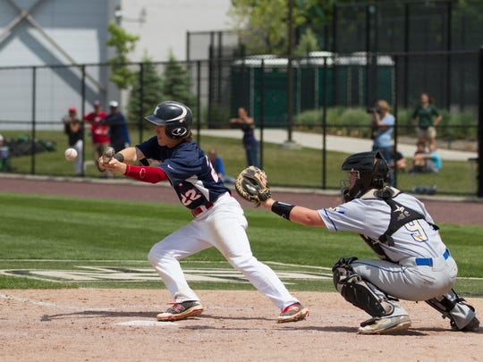 Nick Shepheard lays down a bunt in Ketcham's loss to Webster Schroeder on Saturday.