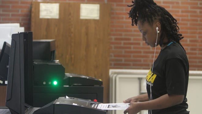 Shavonne Jones cast her ballot after voting in the primary in Rochester at Christ the Good Shepherd Lutheran Church.