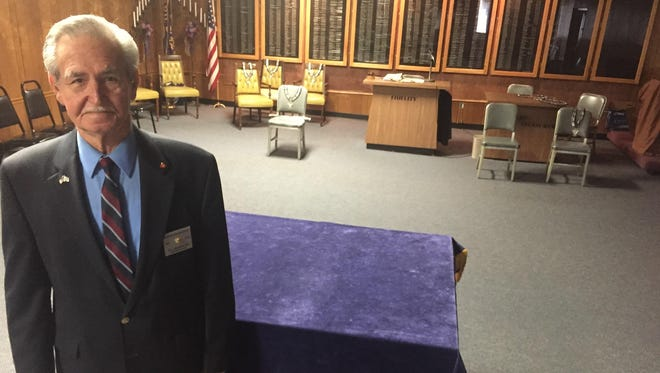 Bill Frommeyer Sr. of Cold Spring, president-elect of all Elks lodge members in Kentucky, stands inside ceremonial meeting chambers inside Newport Elks Lodge 273 in Cold Spring. Behind Frommeyer is a wall listing lodge members who have died.