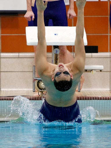Pittsford's Art Fan takes off from the starting block for the backstroke leg of the 200-yard medley relay.