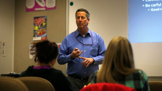 Dr. Julius Manz, director of the Dental Hygiene Program at San Juan College, teaches students on Monday at the college in Farmington. Students in the program, along with area dentists, will host a free dental clinic for children on Friday.