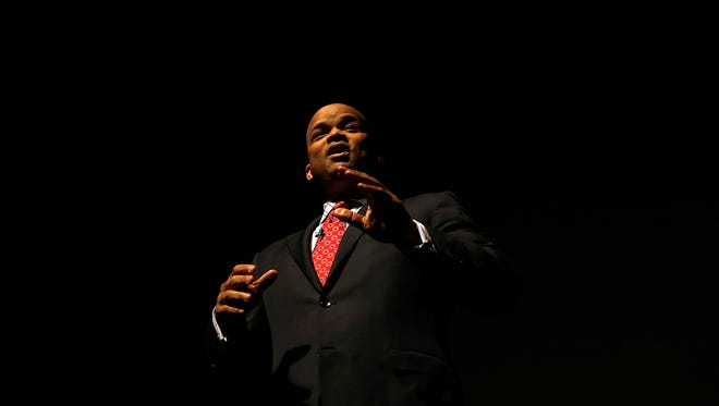 Retired Astronaut Robert Curbeam delivers a presentation on his experiences in space Friday at San Juan College's Henderson Fine Arts Center in Farmington.