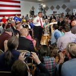 Gov. Chris Christie takes questions during a town hall meeting with area residents in Londonderry, N.H., Wednesday, April 15, 2015. (AP Photo/Jim Cole)