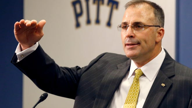 Pat Narduzzi gestures as he speaks at a press conference in Pittsburgh Friday.