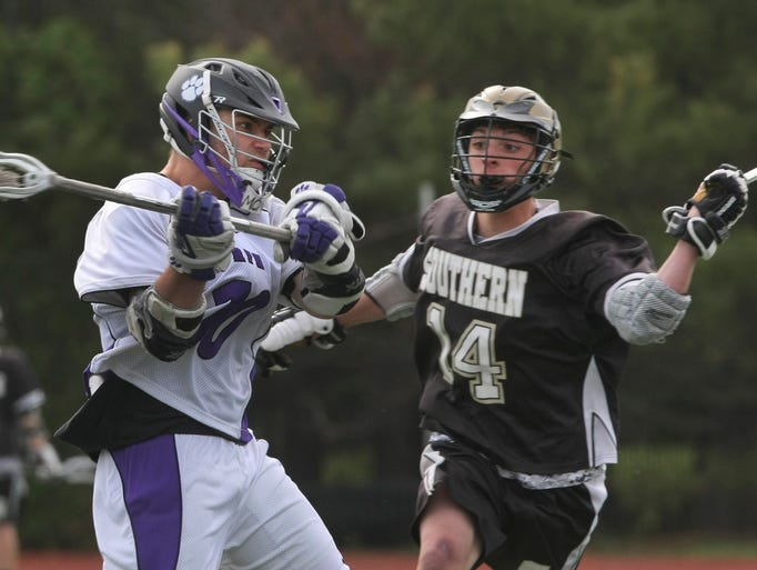 Rumson's Christopher Sutphen blasts a shot for a goal as  Southern Regional's Jon Manzo tries to block his shot.  Rumson-Fair Haven vs Southern Regional during  Boys Shore Conference Lacrosse Final in West Long Branch, NJ on May 13, 2014 in Asbury Park, NJ. Photo by Peter Ackerman