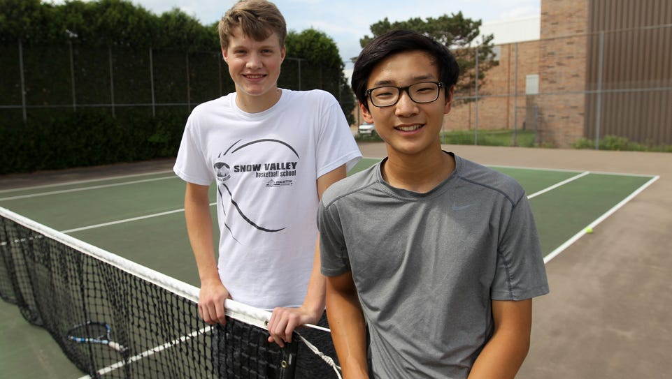 West High's Jiung Jung, right, and City High's Joe