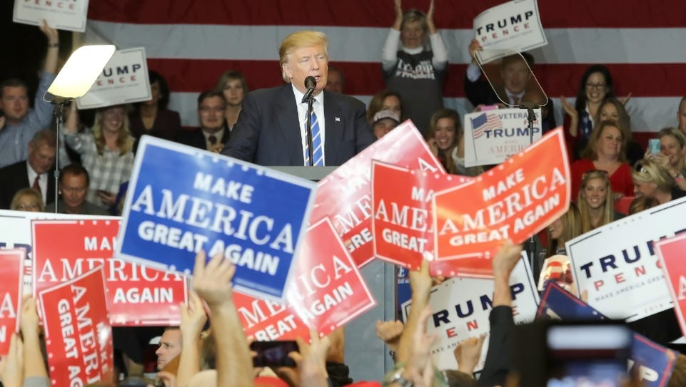 Donald Trump supporters applaud the Republican presidential