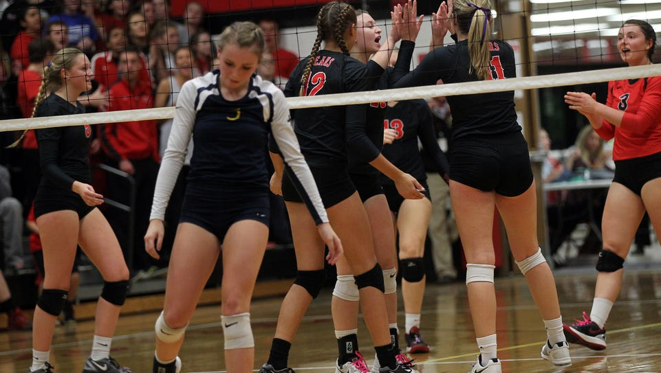 West Branch teammates celebrate a point during their