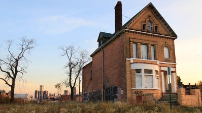 """This home in Detroit represents a typical """"zombie"""" because the property is still going through the foreclosure process but the resident has already fled. Zombies can drag down property values."""