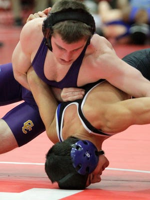 Brad Krebs of Campbell County goes on the offensive against Isaac Shalash of Amelia in a 126-lb match Jan. 10.