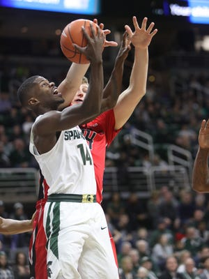 Michigan State Spartans guard Eron Harris scores against Rutgers center CJ Gettys during the first half Wednesday, Jan. 4, 2017 at Breslin Center in East Lansing.