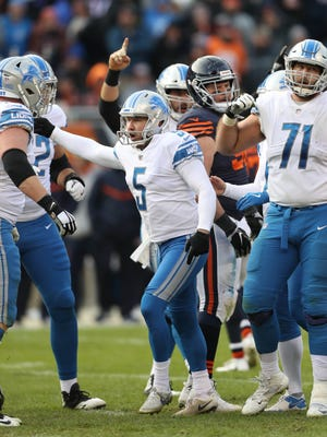 Matt Prater celebrates after kicking the winning field goal in the fourth quarter of the Detroit Lions' 27-24 win over the Chicago Bears, Sunday, Nov. 19, 2017 at Soldier Field in Chicago.