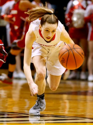 Jackson Northwest's Sydney Shafer runs after the loose ball during Northwest's win in the Class B state semifinal at Calvin College's Van Noord Arena in Grand Rapids on Friday, March 16, 2018.