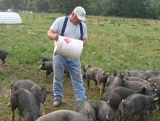 john_backes_feeding_piglets-courtesy Marina Backes
