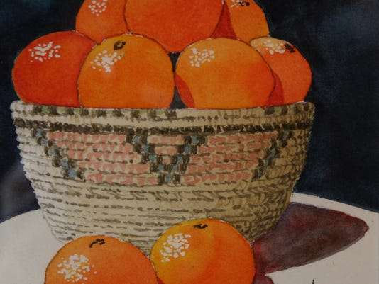 basket of citrus by John Anderson