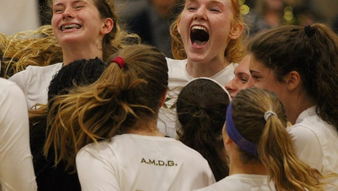 Xavier Prep volleyball players celebrate their second round CIF playoff game against Vistamar in Palm Desert on November 2, 2017. The saints won in straight sets and advance to the quarterfinal match.