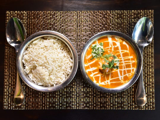 Chicken tikka masala dish at Mausam Express, a quick-service