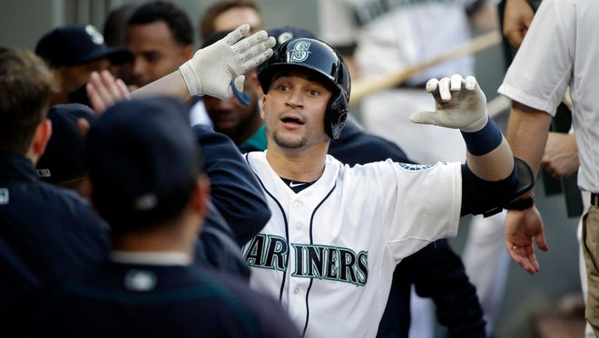 Seattle Mariners' Mike Zunino is congratulated on his home run against the Cleveland Indians in a baseball game Thursday, May 28, 2015, in Seattle.