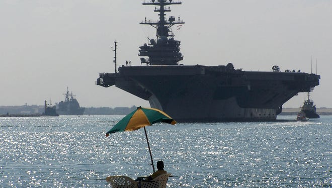 A U.S. aircraft carrier moves through the Suez Canal in 2011.