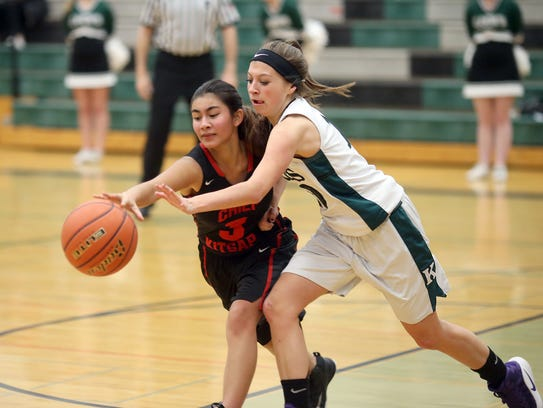Kai Usman of Chief Kitsap tries to poke the ball away from Klahowya's Kylie Woodrum. Chief Kitsap had just six players in uniform against Klahowya.