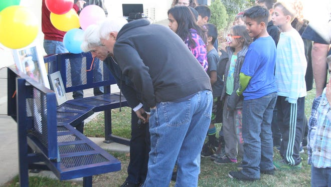 Guests admire a bench dedicated to former Fernley Elementary School student Haylie Chmela in a ceremony that took place Nov. 18 at the school.