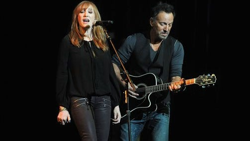 Patti Scialfa, left, and Bruce Springsteen perform at the 8th Annual Stand Up For Heroes, presented by the New York Comedy Festival and The Bob Woodruff Foundation, at the Theater at Madison Square Garden on Wednesday  in New York.