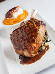 Bone-in pork chop with greens, whipped bourbon sweet