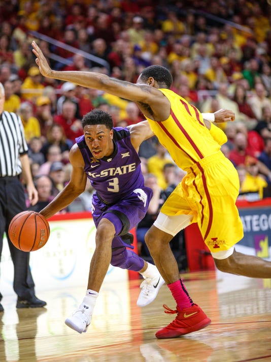 Kansas State University's Kamau Stokes (3) drives to the basket under Iowa State's Monte Morris (11) during the first half of an NCAA college basketball game, Tuesday Jan. 24, 2017, in Ames, Iowa. (AP Photo/Scott Morgan)