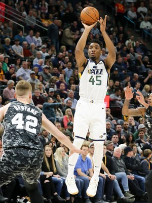 Utah Jazz guard Donovan Mitchell (45) shoots a jump shot against the San Antonio Spurs during the first quarter at Vivint Smart Home Arena.