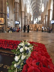 The wedding bouquet of Britain's Princess Eugenie is laid on the Grave of the Unknown Warrior in Westminster Abbey in London, Saturday, Oct. 13, 2018, a day after her wedding to Jack Brooksbank in Windsor.
