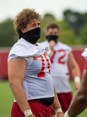 Third-year sophomore, offensive guard, Luke Jones looks on during a Saturday walkthrough practice on the Hill. Since his return to the Razorbacks, Jones has gained recognition for his versatility on the o-line from Coach Pittman going into the 2020 season.
