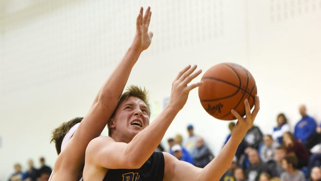 Philo's Evan Smith draws contact during Friday night's game against West Muskingum. Philo went on to edge the Tornadoes 48-45. For more photos, visit www.zanesvilletimesrecorder.com.