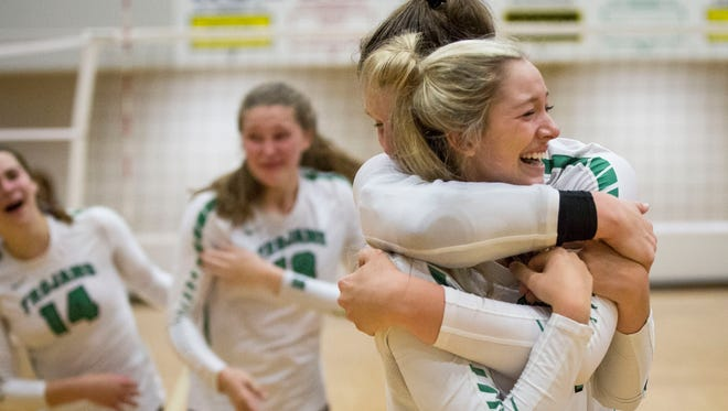 New Castle, shown here celebrating after beating Wapahani Oct. 14 in sectional play, won its fifth regional championship by defeating Fort Wayne Bishop Dwenger and Bellmont.