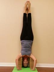 Heather Olson of Joyful Yoga and Yoga Bird is in supported Headstand.