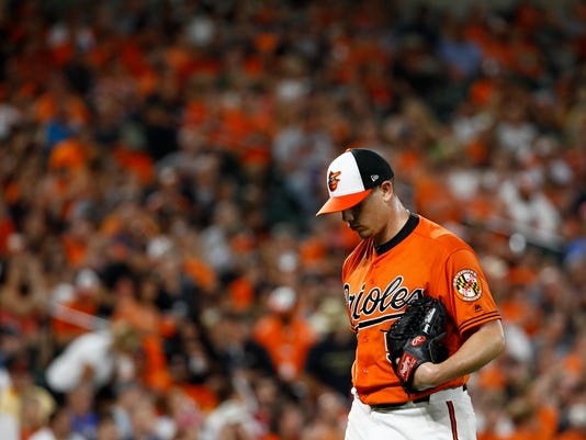 Baltimore Orioles starting pitcher Jeremy Hellickson walks off the field after throwing in the top of the third inning of a baseball game against the Tampa Bay Rays in Baltimore, Saturday, Sept. 23, 2017. Hellickson gave up a three-run home run to Tampa in the third. (AP Photo/Patrick Semansky)