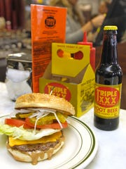 The Duane Purvis All-American burger is one of the many chopped steak selections for regulars of Triple XXX.