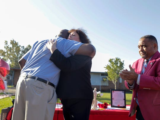 Principal Rogers Griffin, left, hugs Cindy Bishop of the Louisiana Orthopedic Association and Athletic Trainers Association after being presented an automated external defibrillator (AED)  Nov. 3, 2016. at the Holy Family School in Lafayette, where  student died of a heart failure last year.