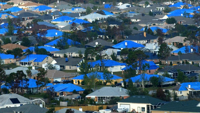 Blue Roofs cover the homes near Grande Lagoon on the west side of Pensacola months after Hurricane Ivan's devastation.