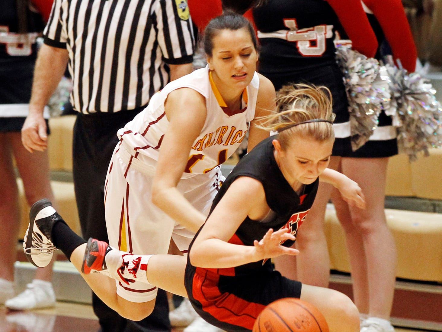 Rileigh McTagertt of Lafayette Jeff is fouled by Katee Kurtz of McCutcheon in girls sectional basketball action Friday, February 13, 2015, at McCutcheon High School. McCutcheon defeated Lafayette Jeff 43-33.