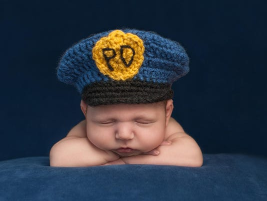 Newborn Baby Bloy Wearing a Police Hat