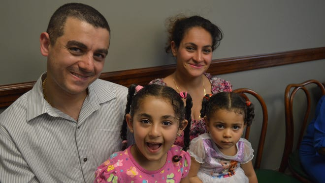 Marko Sergius and his family were at Ardsley Village Hall on June 11 for the lottery for 17 affordable condominiums. His name was picked sixth. With Sergius is his wife, Mourven, and daughters Maroska, left, and Melissa.