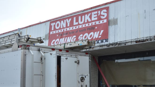 Tony Luke's will open on 33rd St in Ocean City this May. Crew workers are working hard to get the space ready.